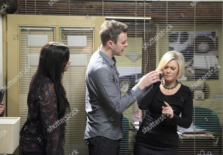 Eve [Suzanne Shaw] answers the phone to a mysterious female caller who asks her to tell Jimmy that she's sorry.  Carl King [Tom Lister]  grabs the phone as Scarlett Nichols [Kelsey-Beth Crossley] and Edna Birch [Shirley Stelfox] look on.
