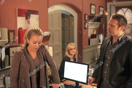 Stock Photo of Ella Hart [Corrinne Wickes] , Dermott Macey [Frank Kelly]  and Declan Macey [Jason Merrels]  are all surprised to see Katie Sugden [Sammy Winward] back at work so soon. They are concerned when she starts crying.