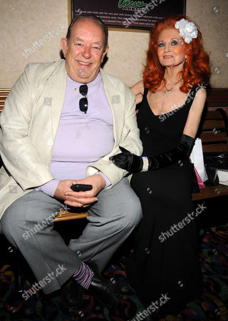 Stock Photo of Robin Leach and Tempest Storm
