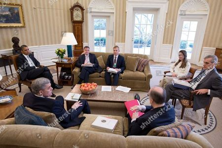 President Barack Obama meets with National Security staff in the Oval Office. From left are: Douglas E. Lute, Senior Director for Afghanistan and Pakistan; Jeff Eggers, Director for Afghanistan and Central Region; David Holmes Director for Afghanistan; National Security Advisor Tom Donilon; Avril Haines, Deputy Counsel to the President; and Deputy National Security Advisor Denis McDonough, Washington DC, America