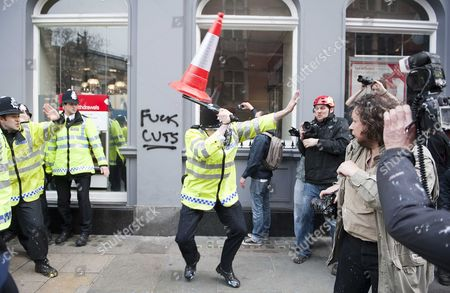 Picture Shows Policeman Defending Himself Against Apparently