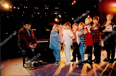 Lionel Bart At The Piano Auditioning Children For The Musical Oliver Which He Produced