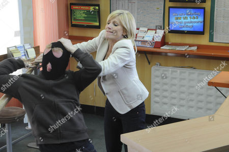 Stella Price [Michelle Collins] endangers herself to protect Leanne Barlow. Stella is in the bookies when a Martin Glover with a baseball bat threatens Leanne, demanding she empty the till. Fearless Stella wrestles him to the ground.