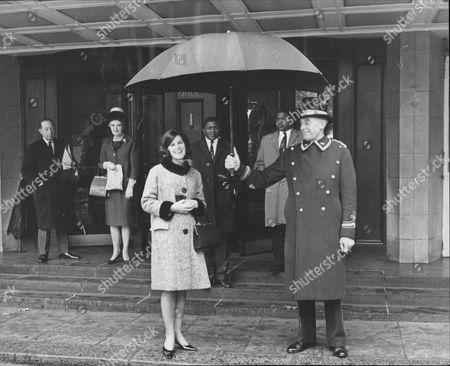 Stock Image of Janet Elizabeth Davison Of Toowoomba Australia Winner Of Girl In A Million Contest Here Under Umbrella At Dorchester Hotel London 1964.