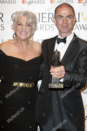 John Hodge and Tyne Daly accept the award for Best New Play
