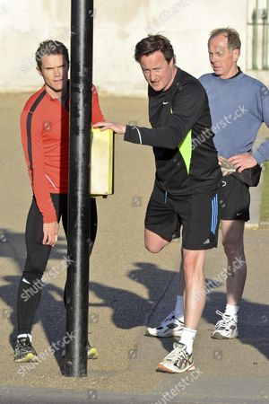 Matt Roberts and David Cameron with close protection officer