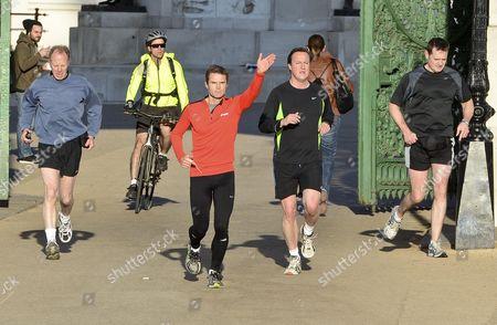 Matt Roberts and David Cameron with close protection officers