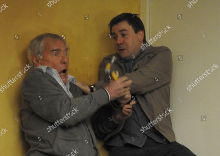 Alan Hoyle [John Woodvine] is about to attack John Stape [Graeme Hawley] but it goes wrong and he ends up falling down the stairs.