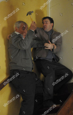 Stock Image of Alan Hoyle [John Woodvine] is about to attack John Stape [Graeme Hawley] but it goes wrong and he ends up falling down the stairs.