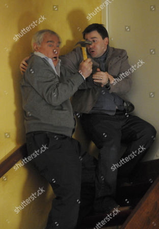 Stock Photo of Alan Hoyle [John Woodvine] is about to attack John Stape [Graeme Hawley] but it goes wrong and he ends up falling down the stairs.