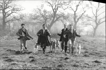 Chris Larner Philip Wright Darren Tunstall And Hal Flower Actors Running With Greyhound Dogs To Publicise Play The Gambler 1990.