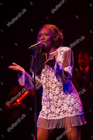 Emi Wokama (as Tina Turner)
