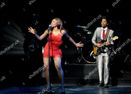 Emi Wokama (Tina Turner) and Chris Tummings (Ike Turner)