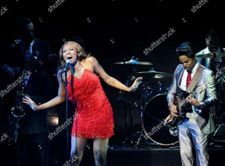 Stock Image of Emi Wokama (Tina Turner) and Chris Tummings (Ike Turner)