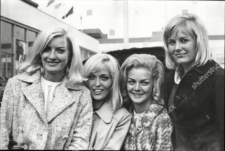 Editorial photo of All Smiles On Arrival In London To-day Are Four Of The Of The Lionel Blair Dancers Back In This Country After A Two Month Tour Of The Far East. They Are Diana Williams Jackie Irving Eithne Milne And Jennifer Wright