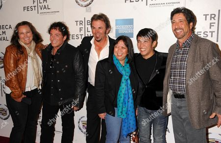 Stock Picture of Journey Band Members L-R: Neal Schon, Jonathan Cain, Arnel Pineda, Director Ramona S. Diaz