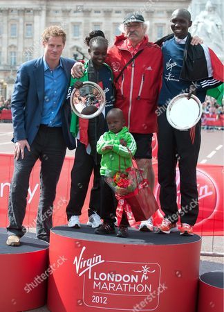 Stock Image of Women's Gold medal winner Mary Keitany of Kenya with son Jared, Prince Harry and Men's Gold medal winner Wilson Kipsang of Kenya, race director David Bedford