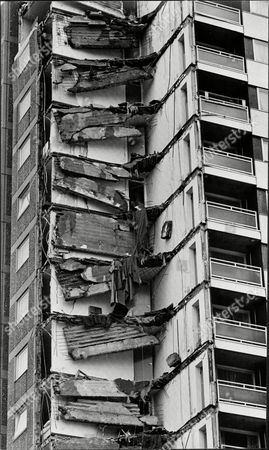 Explosion At Ronan Point Flats At Canning Town East London Picture Shows The Damage To The Building Ronan Point Was A 22-story Tower Block In Newham East London Which Suffered A Partial Collapse When A Gas Explosion Demolished A Load-bearing Wall Causing The Collapse Of One Entire Corner Of The Building. Four People Were Killed In The Incident And Seventeen Were Injured. Ronan Point Named After Harry Louis Ronan (a Former Chairman Of The Housing Committee Of The London Borough Of Newham) Was Part Of The Wave Of Tower Blocks Built In The 1960s As Cheap Affordable Prefabricated Housing For Inhabitants Of The West Ham Region Of London. The Tower Was Built By Taylor Woodrow Anglian Using A Technique Known As Large Panel System Building Or Lps. This Involved Casting Large Concrete Prefabricated Sections Off-site Then Bolting Them Together To Construct The Building. Building Started In 1966 And Construction Was Completed On 11 March 1968.