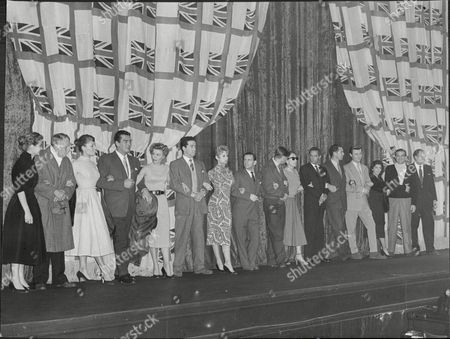 Royal Command Film Performance. The Line Up Of Stars (left To Right) Sylvia Sims A.e. Matthews Belinda Lee Victor Mature Vera Ellen John Gregson Brigitte Bardot Norman Wisdom Ian Carmichael Joan Crawford Peter Finch Antony Quayle Laurence Harvey And Maureen Swanson Dana Andrews And Bernard Lee