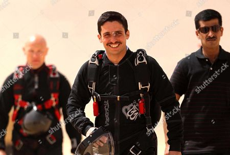 Jordanian Prince Hamzah (c.), president of the Royal Aero Sports Club of Jordan, attends a media event to announce the launch of 'Skydive Jordan' in the Wadi Rum desert