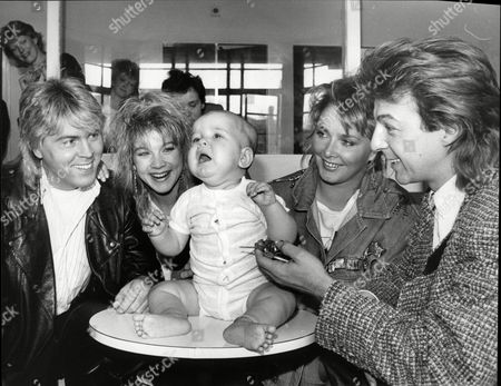 Editorial picture of Bucks Fizz The Eighties Pop Group With Baby Michael Boulding (10 Months) Of Tonbridge Wells Kent At The Childrens Neurosurgery Unit At Dulwich London Left To Right Mike Noloan Shelly Preston Baby Michael Boulding Cheryl Baker And Bobby Gee