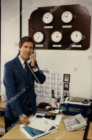 Robert Cole Of Travel Agents Uniglobe Seen Here On Telephone 1992.