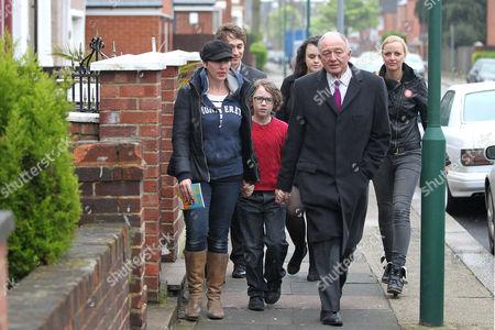 Ken Livingstone, wife Emma Beal and children on the way to a polling station