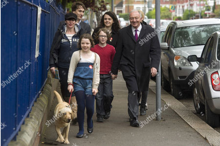 Stock Image of Ken Livingstone, wife Emma Beal and family on the way to a polling station