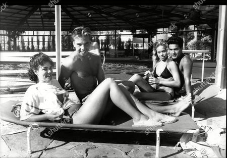 Jane Thurwell And Lorraine Cox With Their Boyfriends Julian Jackson And Steven Roberts - Holiday Makers Sunbathing By Pool At Hotel In Majorca 1989.