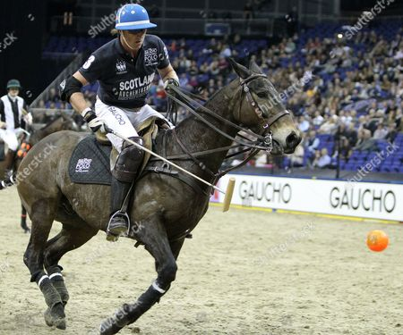 Picture by Paul Terry/Focus Images Ltd. 07545642257.21/03/12.Jamie Le Hardy ( R) of Scotland in action during the HPA Gaucho Polo event at the O2 arena, London.
