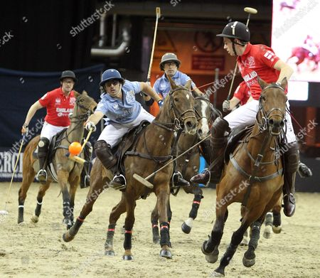 Picture by Paul Terry/Focus Images Ltd. 07545642257.21/03/12.Oscar Mancini (C ) of Argentina  shows his skills during the HPA Gaucho Polo event at the O2 arena, London.