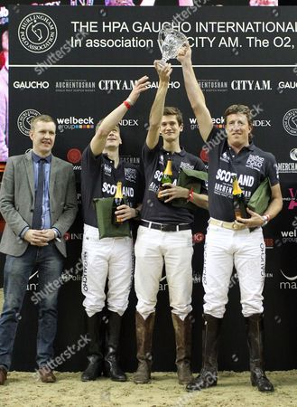 Picture by Paul Terry/Focus Images Ltd. 07545642257.21/03/12.The Scotland receive their trophy after winning the first match at the HPA Gaucho Polo event at the O2 arena, London.