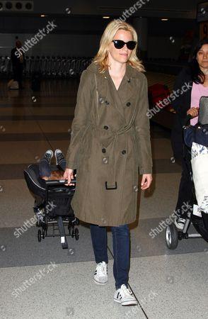 Editorial photo of Elizabeth Banks and baby Felix Handelman arrive at JFK airport, New York,  America - 06 May 2012