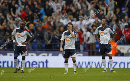 Nigel Reo-Coker, Mark Davies and Zat Knight of Bolton Wanderers shows a look of dejection after James Morrison of West Bromwich Albion scores the late equaliser, 2-2