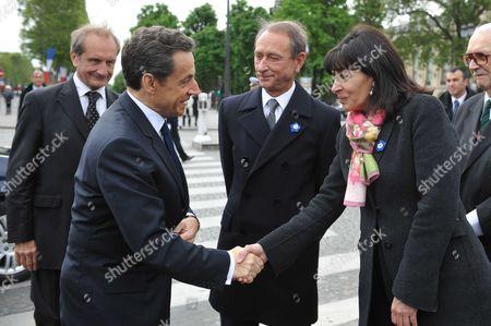 Outgoing French President Nicolas Sarkozy, Gerard Longuet, Anne Hidalgo and Bertrand Delanoe