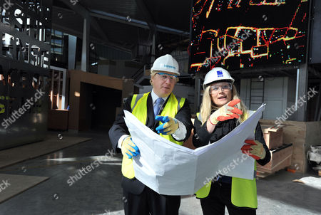 Stock Image of London Mayor Boris Johnson is shown designs by designer Abby Coombs during a visit the Crystal visitors centre by the Emirates Cable Car in East London, on the final week of his Mayoral Campaign