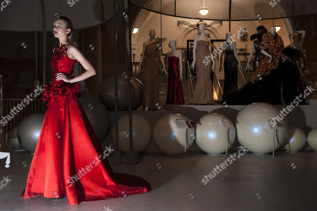 Stock Photo of Model Zhanna Emelyanova in a sumptuous red silk satin ballgown from Giles Deacon's current collection