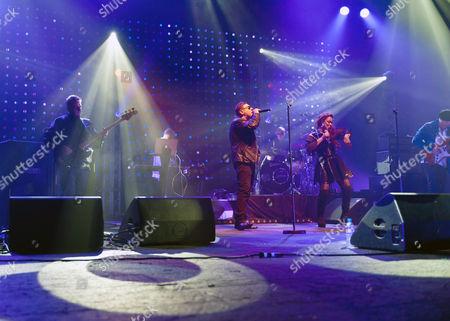Happy Mondays - Paul Ryder (bass), Paul Davies (Keyboards), Shaun Ryder (vocals), Drummer (Gary Whelan), Rowetta Satchell (vocals), Mark Day (guitar)