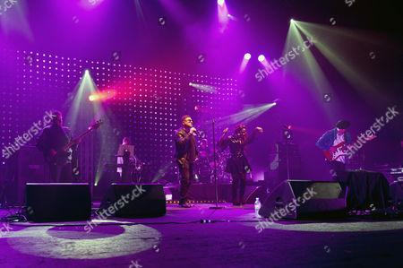 Happy Mondays - Paul Ryder (bass), Paul Davies (Keyboards), Shaun Ryder (vocals), Drummer (Gary Whelan), Rowetta Satchell (vocals), Mark Day (guitar).