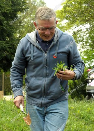 Stock Image of Jo Yeates' father David plants a flower