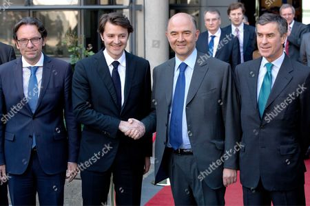 Frederic Lefebvre, outgoing Finance Minister Francois Baroin, new Finance Minister Pierre Moscovici and new JM of Budget Jerome Cahuzac