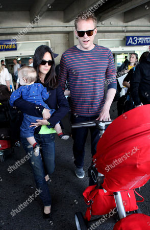 Stock Picture of Jennifer Connelly with husband Paul Betty and daughter Agnes Lark Bettany