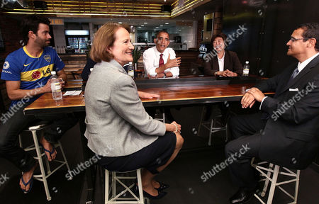 United States President Barack Obama visits Taylor Gourmet, a sandwich restaurant, with Small Business Administrator Karen Mills (2nd L). Also pictured (L-R) are Casey Patten and David Mazza, founders and co-owners Taylor Gourmet; Cathy Rachels, President of Yes! Organic Markets and Brian J. Smith, Founding Principal Francis Lee Contracting