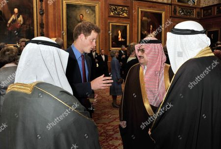 Prince Harry talks to Prince Mohammed bin Nawwaf bin Abdul Aziz Al Saud of Saudi Arabia