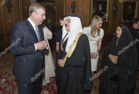 Stock Image of Prince Andrew with King Hamad bin Isa Al Khalifa, the King of Bahrain and Princess Beatrice with Queen Sabika bint Ibrahim Al Khalifa