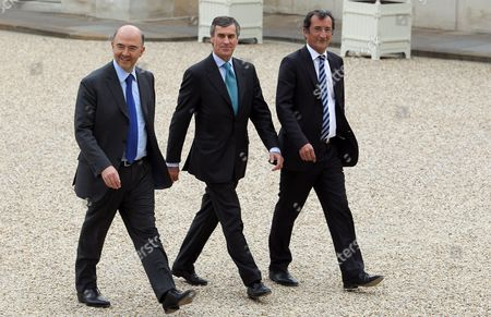 France's newly-appointed Economy, Finance and Foreign Trade Minister, Pierre Moscovici, Junior Minister for Budget, Jerome Cahuzac and Junior Minister for Cities, Francois Lamy