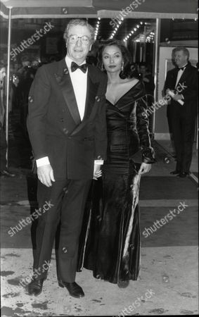 Actor Michael Caine With Wife Shakira Baksh (mrs Shakira Caine) At Royal Film Premiere Of 'without A Clue' At Odeon Leicester Square