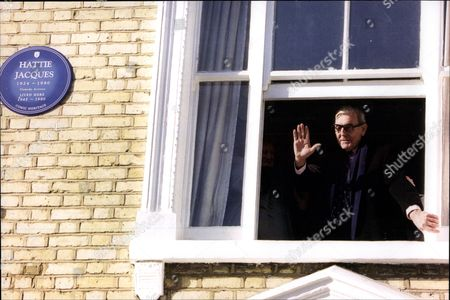 Editorial image of Actor Eric Sykes Waves From The Window Of The Home Where Actress Hattie Jacques Lived Blue Plaque Visible.