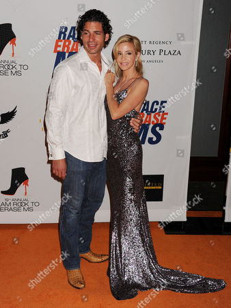 Stock Photo of Dimitri Charalambopoulos and Camille Grammer