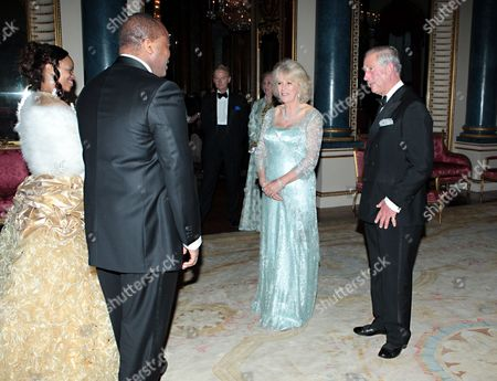 Stock Photo of Prince Charles and Camilla Duchess of Cornwall greet King Mswati III and wife Inkhosikati LaMbikiza of Swaziland